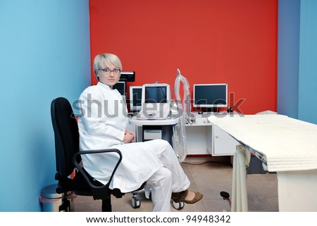 doctor vet woman work at surgery room on ill animal cat and dog giving help and medical care - stock photo