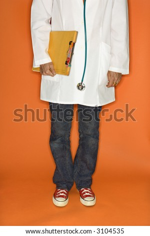 Doctor wearing jeans and sneakers. - stock photo