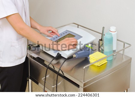 Doctor while setting up ultrasound machine  - stock photo