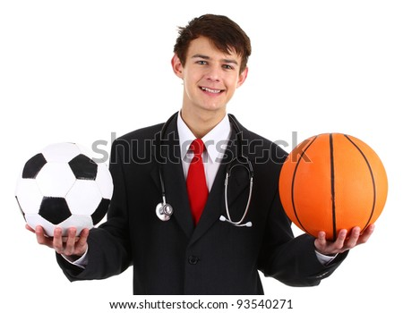 Doctor with a bsketball and a football, isolated on white. - stock photo