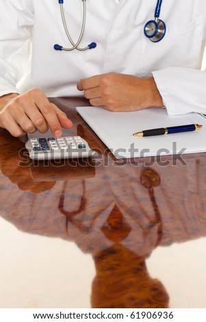 Doctor with a calculator. Calculation of costs and revenue in physician practice and hospital - stock photo