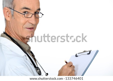 Doctor with a clipboard - stock photo