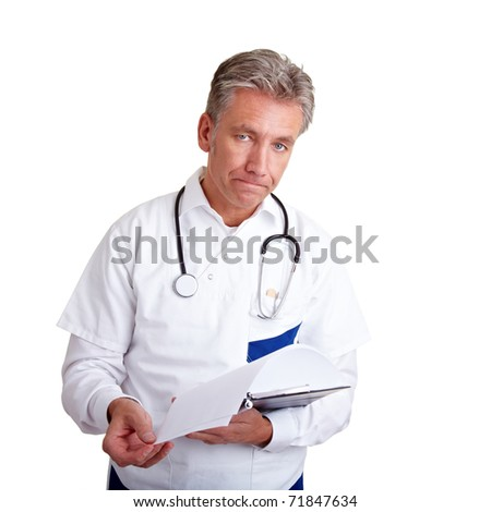 Doctor with a clipboard trying to deliver bad news - stock photo
