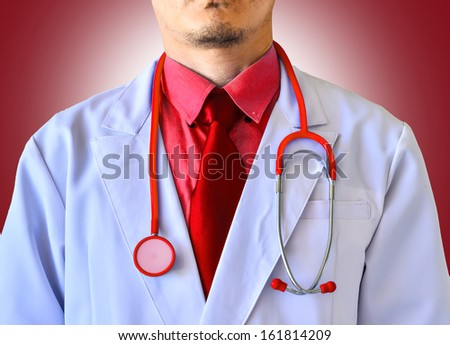Doctor with a stethoscope close up on red background - stock photo