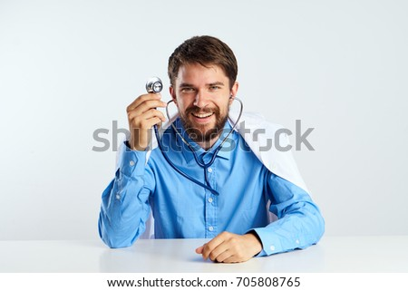 Doctor with a stethoscope on a light background, medicine, hospital