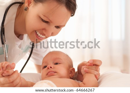 Doctor with baby on a white background - stock photo