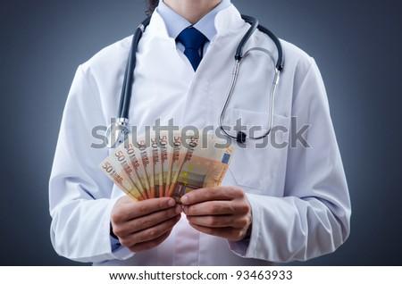 Doctor with euro money - stock photo