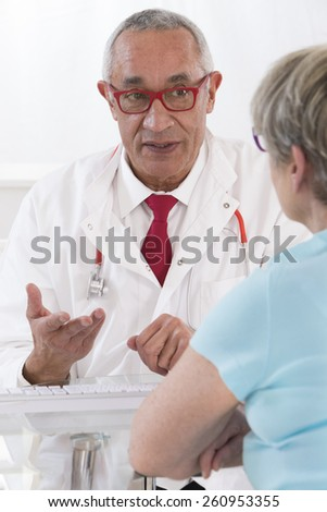 Doctor with female patient - stock photo