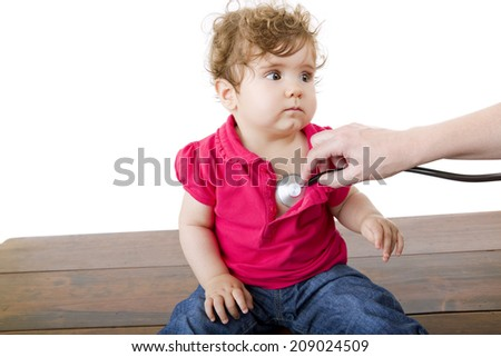 doctor with happy baby making examination - stock photo