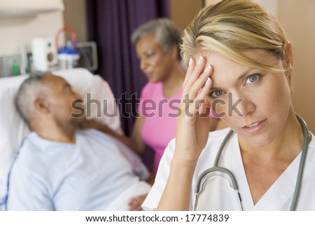 Doctor With Headache In Patients Room