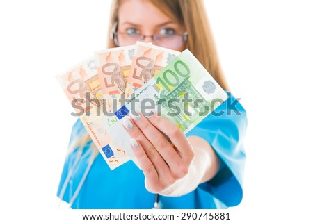 Doctor with her money in blue coat.