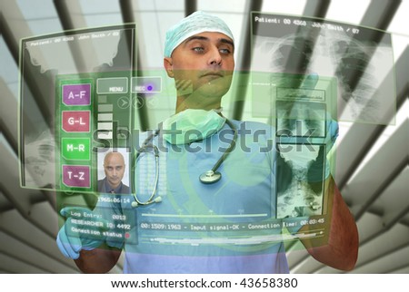 Doctor with high-tech computer screen viewing patient data - stock photo