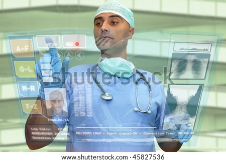 Doctor with hightech computer screen viewing patient data - stock photo