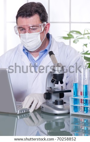 doctor with laptop at laboratory