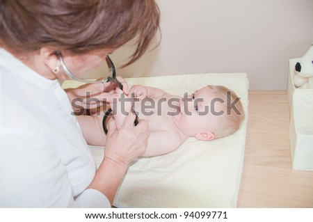 Doctor with little child