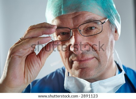 Doctor with Mask & Stethoscope arms folded - stock photo