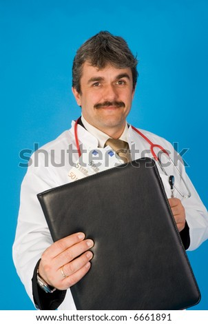 doctor with money - stock photo