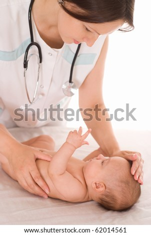 Doctor with newborn child on a white background