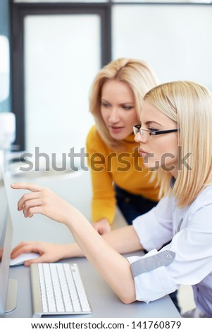 Doctor with patient in office - stock photo