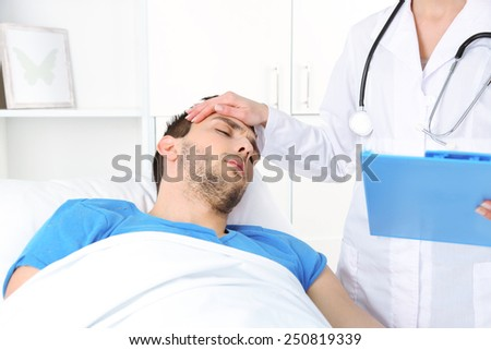 Doctor with patient in room - stock photo
