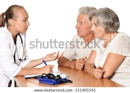 Doctor with patients sitting at a table