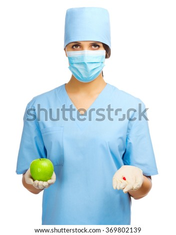 Doctor with pill and apple isolated - stock photo