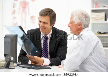 Doctor with senior patient - stock photo