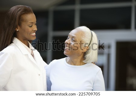 Doctor with Senior Woman - stock photo
