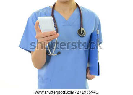Doctor with smart phone  - stock photo