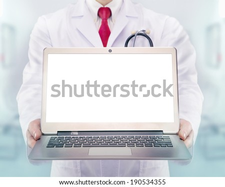 Doctor with stethoscope and laptop in a hospital - stock photo