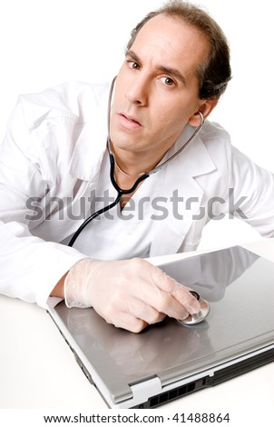 Doctor with stethoscope fixing laptop, good technical support symbol. - stock photo