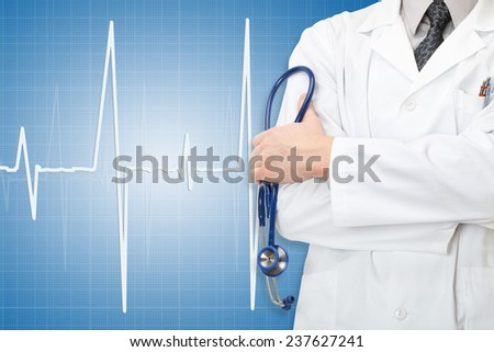 Doctor with stethoscope in hand and electrocardiogram on blue background - stock photo