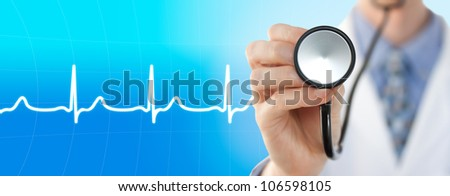 Doctor with stethoscope on the electrocardiogram graph background - stock photo