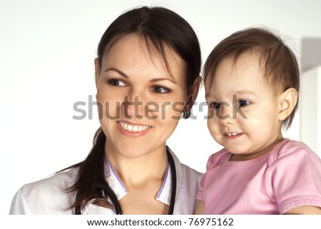 doctor with stethoscope picking a baby on white