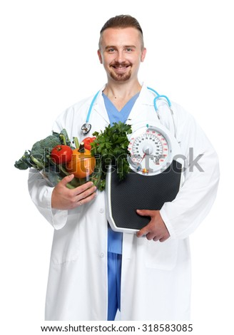 Doctor with vegetables and body scales. Weight loss and diet. - stock photo