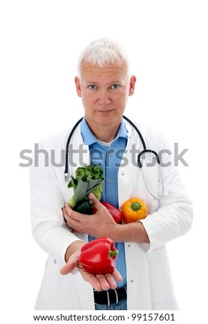 Doctor with vegetables presenting on his hand