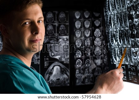 Doctor with x-ray photo - stock photo
