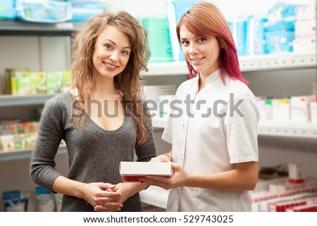 Doctor woman and her client in the warehouse looking at the camera