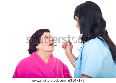 Doctor woman giving medicines to an elderly woman isolated on white background