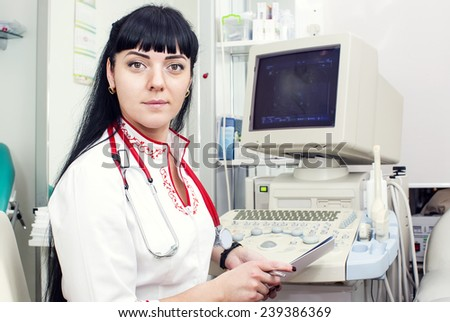 Doctor woman in the office of ultrasound - stock photo