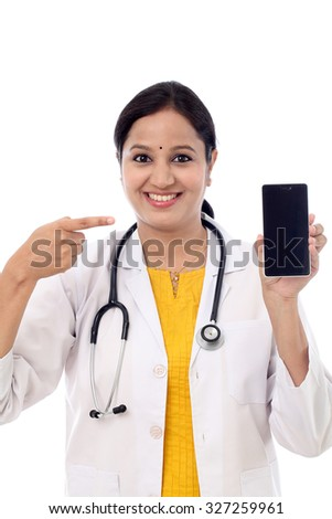 Doctor woman pointing on smart phone screen - stock photo