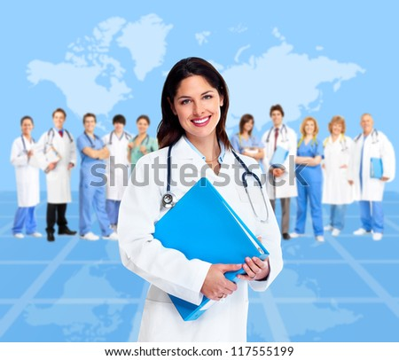 Doctor woman with a medical team. Health care background. - stock photo