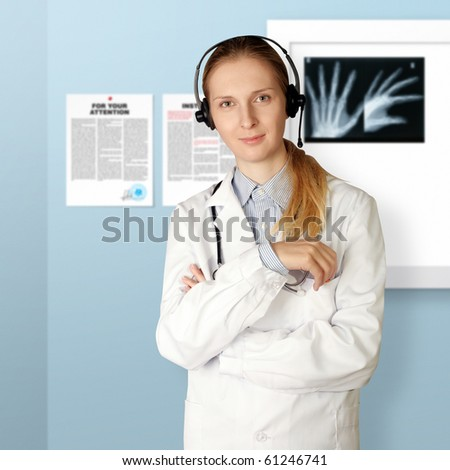 doctor woman with headphones smile at camera isolated on different backgrounds - stock photo