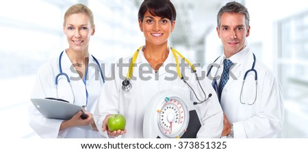Doctor woman with scales and apple. - stock photo