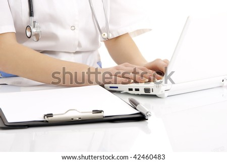 Doctor working on the laptop. Isolated. - stock photo