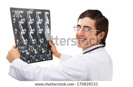 Doctor working with CT scan - stock photo
