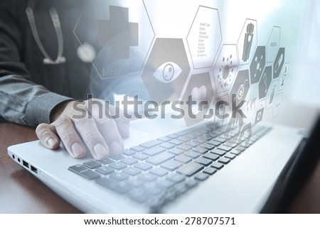 Doctor working with digital tablet and laptop computer in medical workspace office and overcast exposure effect - stock photo