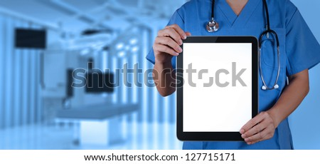 Doctor working with tablet computer with operating room - stock photo