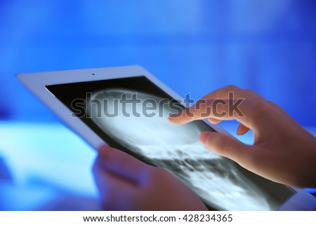 Doctor working with tablet-pc, close up - stock photo