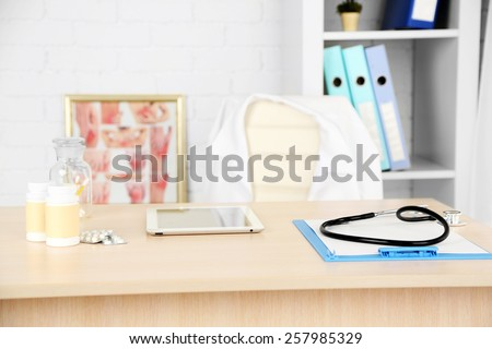 Doctor workplace in office - stock photo